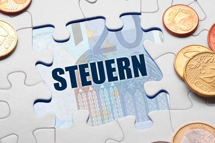 Puzzle mit Wort Steuern